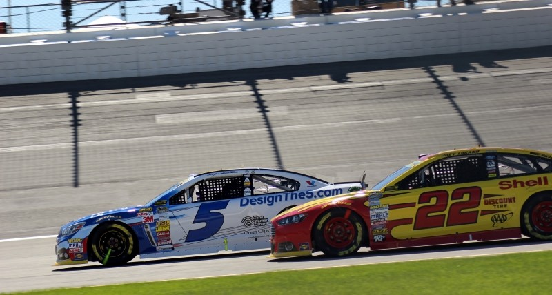 Kasey Kahne and Joey Logano leaving Pits